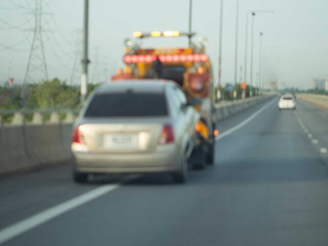 Tow truck, rotator truck, wrecker, emergency roadside assistance